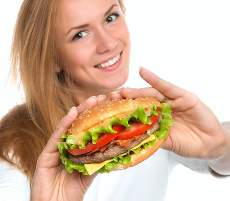 Woman showing tasty unhealthy burger sandwich in hands hungry getting ready to eat isolated on a white background Fast food concept Imagens - 36351490