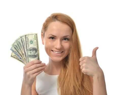 five dollars: Happy young woman holding up cash money dollars in other compare thinking looking at the corner isolated on a white background