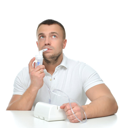 Young man using nebulizer for respiratory inhaler Asthma Treatment isolated on a white background
