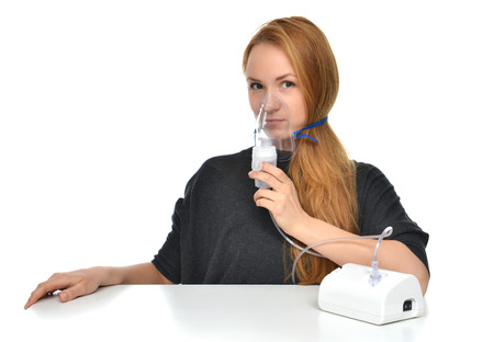 Young woman using nebulizer for respiratory inhaler Asthma Treatment isolated on a white background photo