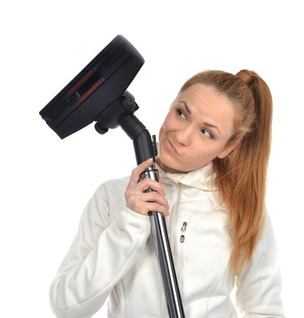 Young happy woman thinking cleaning house floor with vacuum cleaner looking at the corner and smiling isolated on a white background photo