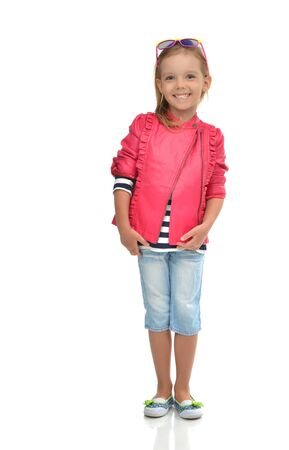 A portrait of laughing fashion little girl full body standing in sunglasses isolated on a white background 版權商用圖片