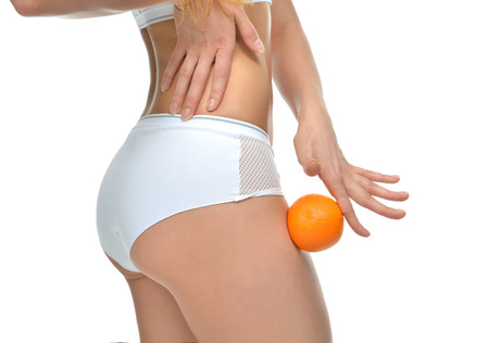 Hips legs buttocks and orange in hand cellulite liposuction woman weight loss control concept isolated against white background