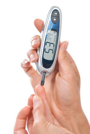 blood sugar: Diabetes patient measuring glucose level blood test isolated on a white background