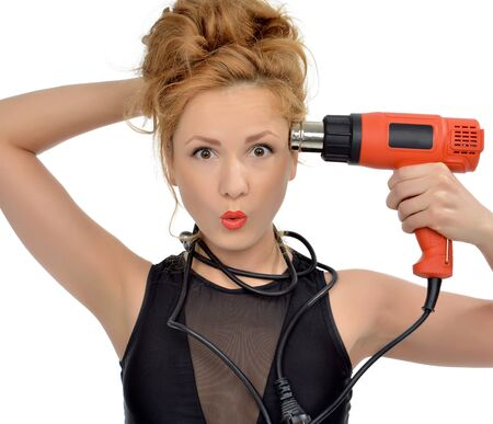 hairdryer: Surprised young sexy woman contractor worker with construction hairdryer dryer tool isolated on a white background