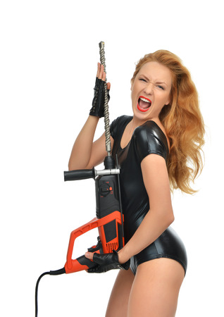 sexy construction worker: Happy young sexy woman contractor worker with construction drill perforator with big concrete bit yelling shouting isolated on a white background