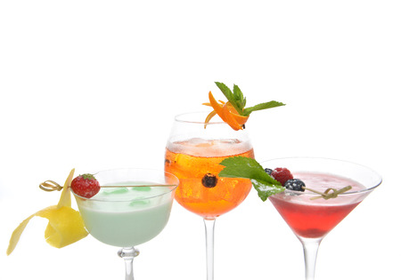 mocktail: Green red orange alcohol margarita martini mojito cocktails collage composition with lemon and mint in cocktail glasses isolated on a white background Stock Photo