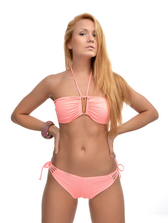 swimsuite: Young beautiful woman posing in modern pink pattern bikini swimsuite with text space on a white background