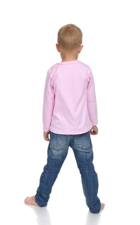 small butt: Rear view of caucasian full body american baby boy kid in pink sweater and jeans standing isolated on a white background