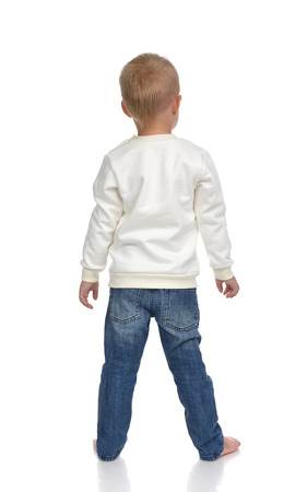 back view: Rear view of caucasian american baby boy kid in sweater and jeans isolated on white background Stock Photo