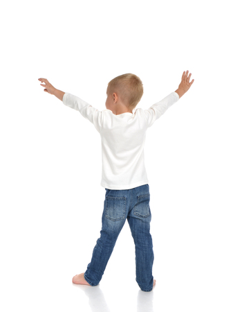 small butt: Rear view of caucasian full body american baby boy kid with arms open feeling freedom and happiness standing isolated on a white background Stock Photo