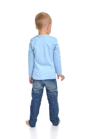 small butt: Rear view of caucasian full body american baby boy kid in blue sweater and jeans standing isolated on a white background