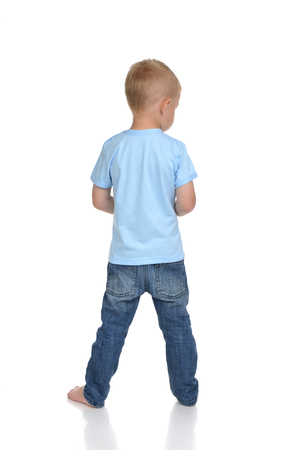 small butt: Rear view of caucasian full body american baby boy kid in blue tshirt and jeans standing isolated on a white background
