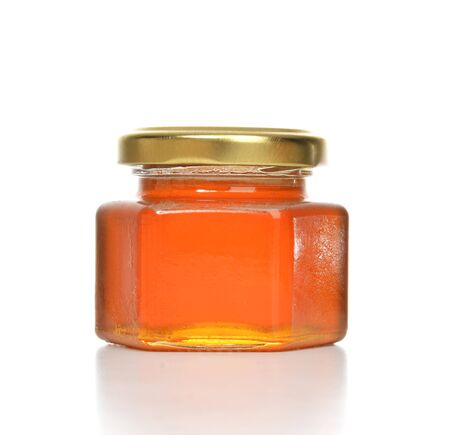 honey jar: Tasty jar of jam or honey with blank text space isolated on a white background