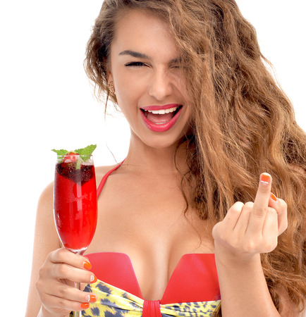 mid morning: Young beautiful woman in bikini hold margarita cocktail juice and show middle finger fuck you off sign isolated on a white background