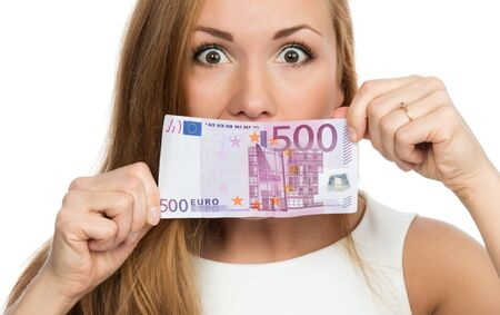 five dollars: Happy young woman holding up cash money five hundred euro in one note in hands yelling and looking at the camera isolated on a white background