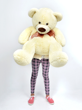 cute teddy bear: Young pretty teenage girl happy hugging big teddy bear instead of head on white background Stock Photo