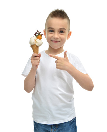 Happy Baby boy holding vanilla ice cream dondurma in waffles cone isolated on a white background Imagens