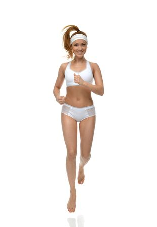 athletic wear: Happy young fitness beautiful slim sport woman jogging and running isolated on a white background Stock Photo