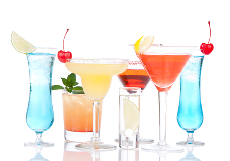 Popular alcoholic cocktails drinks yellow margarita cherry blue curacao and tropical lemon Martini on a white background Foto de archivo