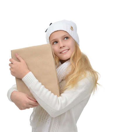 isolates: happy young teen age girl with one parcel box isolates on a white background Stock Photo