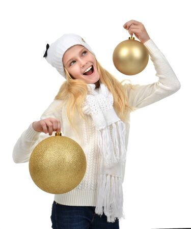 holding a christmas ornament: Young teenage girl holding gold christmas balls holiday decoration happy smiling isolated on a white background