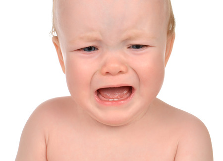 angry baby: Small child baby girl toddler sad crying isolated on a white background