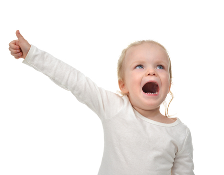 screaming: Child baby toddler happy looking up yelling screaming with hand thumb up sign isolated on a white background Stock Photo