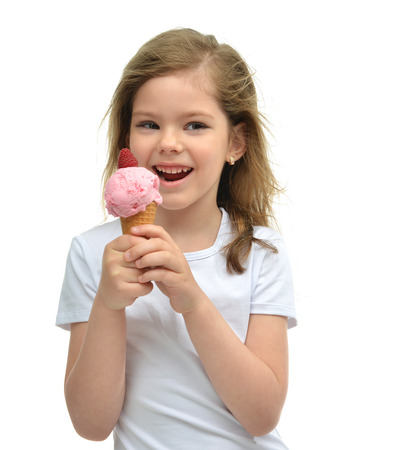 ice: Pretty baby girl kid holding ice cream in waffles cone with raspberry showing happy smiling looking at the corner isolated on a white background