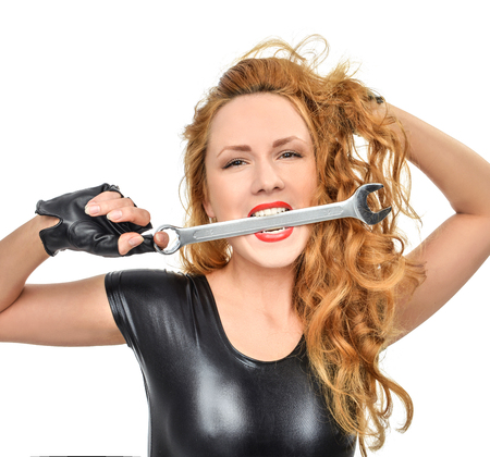 sexy construction worker: Happy young woman contructor worker with construction tool wranch isolated on a white background