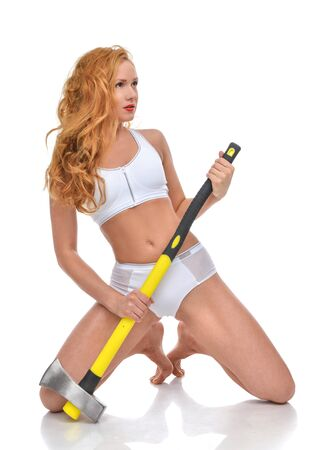 barbarian: Young fashion beautiful woman with big construction yellow axe isolated on a white background