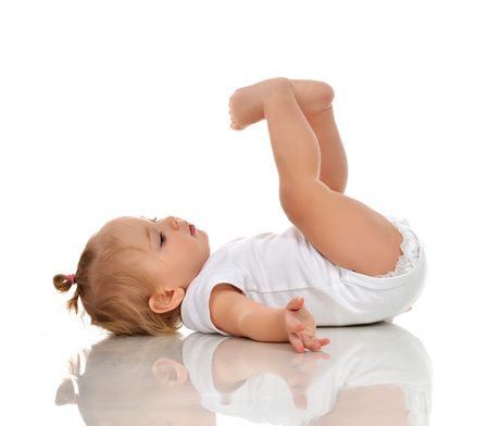 face of infant: Infant child baby girl in diaper lying on a back and looking up isolated on a white background