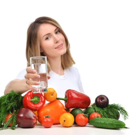 woman eat: Woman with glass of drinking water and green vegetables and fruits isolated on white background. Diet nutrition healthy lifestyle concept
