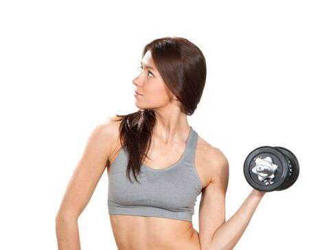 athletic body: Sport brunette fitness woman with perfect athletic body and abs workout with weights lifting dumbbells isolated on a white background Stock Photo