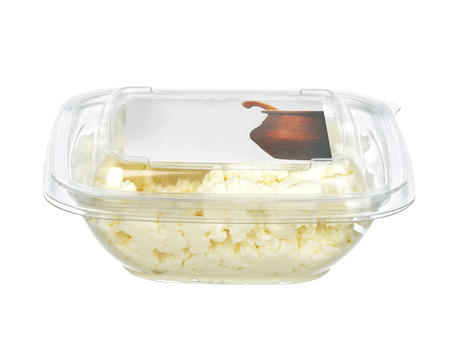 Low fat cottage cheese in single use plastic bowl with text space isolated on a white background Stok Fotoğraf - 55930929