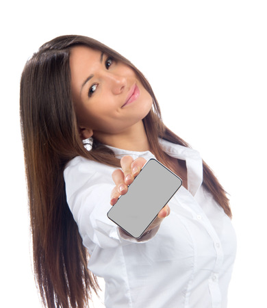 Young Pretty Woman Showing display of her new touch mobile cell phone on a white background. Focus on the hand and phone photo