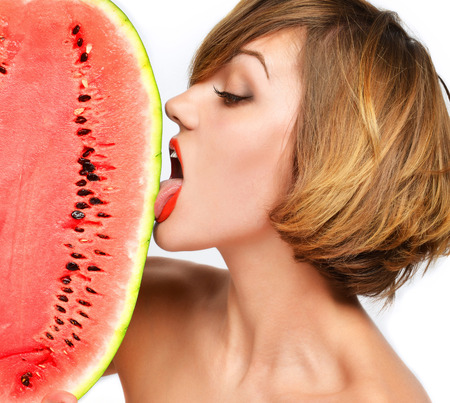 girl licking: Closeup portrait of pretty woman hold in hands and lick fresh red watermelon isolated on a white background