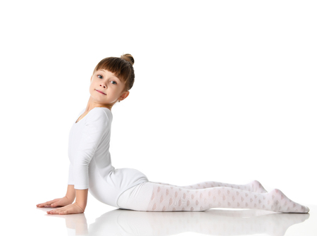 Young sport brunette girl workout stretching exercises in white athletic body cloth looking at camera isolated on white background Stock Photo