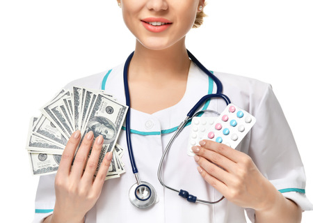 Woman doctor hold in hands and give medicine pills capsules vitamin with dollars money. Medical pharmacy prescription for health cost of the healthy life Banco de Imagens