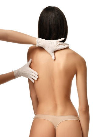 Doctor research patient spine scoliosis deformity backache make massage isolated on a white background