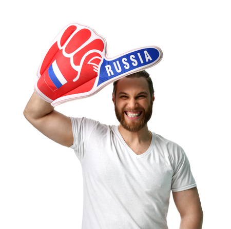 Happy man soccer fan wearing number one Russian foam finger smiling celebrating isolated on white background