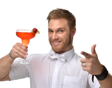 Young man with red strawberry margarita cocktail drink juice happy pointing one finger isolated on white background