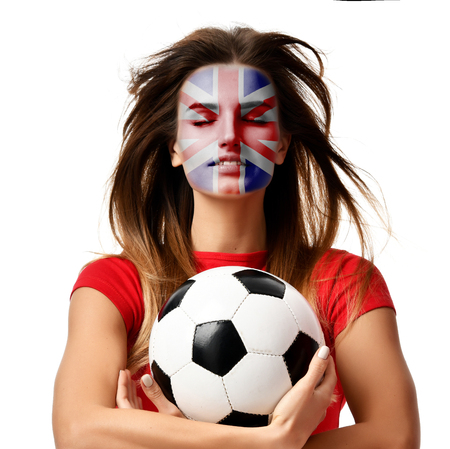 England  fan sport woman player in red uniform hold soccer ball celebrating with windy hair isolated on white background