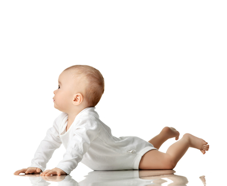 7 month infant child baby  girl toddler lying in white shirt looking at the corner isolated on a white background