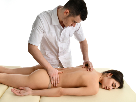 Therapist doctor doing healing physiotherapy treatment on woman neck massage. Alternative medicine, pain relief concept sport injury rehabilitation isolated on white background Stock Photo