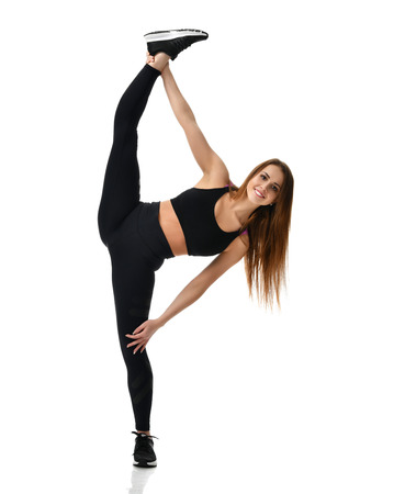 Young sport woman gymnastics doing stretching split fitness exercise workout isolated on a white background Stockfoto
