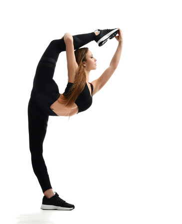 Young sport woman gymnastics doing stretching split fitness exercise workout isolated on a white background 写真素材