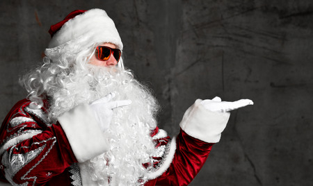 Santa Claus pointing hands at the corner for text copy space. New year and Merry Christmas and happy holidays concept Stock Photo