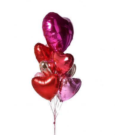 Bunch of metallic red pink heart balloons composition objects for birthday or valentines party isolated on a white background