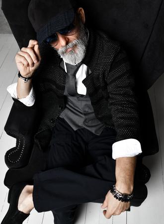 Old brutal senior millionaire man in white shirt and aviator sunglasses stylish fashionable men isolated on white background